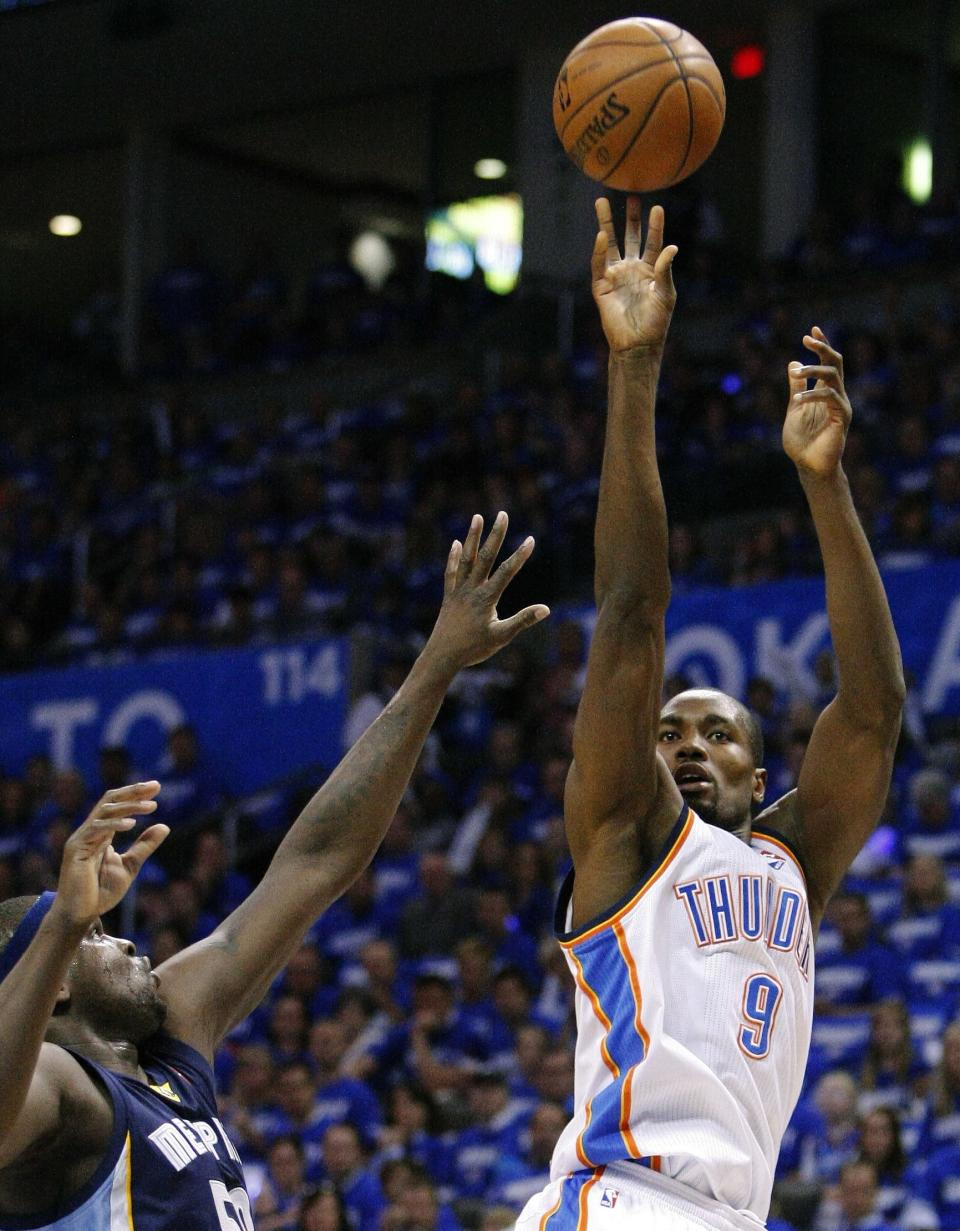 Oklahoma City Thunder forward Serge Ibaka (9) shoots in front of Memphis Grizzlies Zach Randolph during the first quarter of Game 1 of their Western Conference Semifinals NBA basketball playoff series in Oklahoma City, Sunday, May 5, 2013.  (AP Photo/Alonzo Adams)