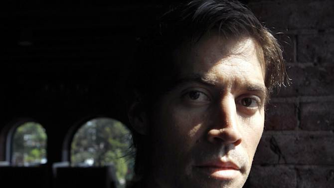 FILE - Journalist James Foley, of Rochester, N.H., is seen in Boston, in a Friday, May 27, 2011 file photo. Foley was kidnapped in northwest Syria by unknown gunmen on Nov. 22, 2012, his parents said Thursday, Jan. 3, 2013. He was in the country contributing videos to Agence France-Press, which has vowed to help secure his release. Foley's parents, John and Diane Foley,  made a public plea Thursday to his captors because the Foleys haven't received any information about their son in six weeks.  (AP Photo/Sreven Senne, File) (AP Photo/Steven Senne, File)
