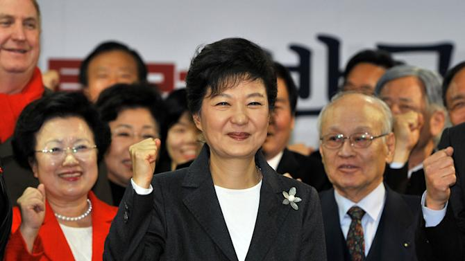 South Korea's president-elect Park Geun-hye, center, shouts her name with members of her election camp during a ceremony to disband the camp at her party's headquarters in Seoul, South Korea, on Thursday, Dec. 20, 2012.  Park's election as South Korea's first female president could mean a new drive to start talks with bitter rival North Korea, though it's unclear how much further she will go than the hard-line incumbent, a member of her own conservative party. (AP Photo/Jung Yeon-je, Pool)