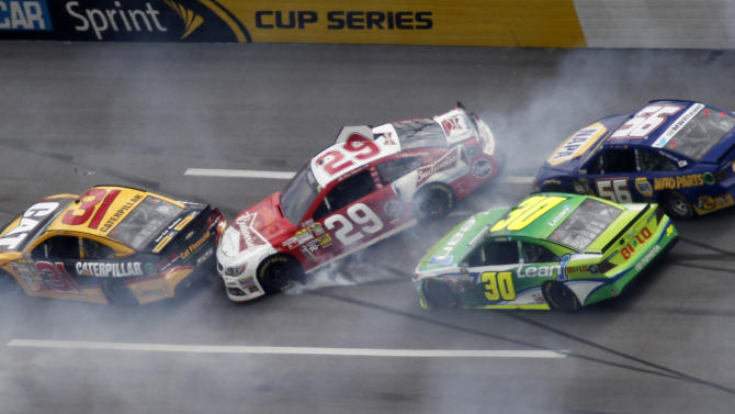 Cars spin through Turn one in a multi-car wreck during the NASCAR Sprint Cup Series Aaron's 499 auto race at Talladega Superspeedway in Talladega, Ala., Sunday, May 5, 2013. From left: Jeff Burton (31), Kevin Harvick (29), David Stremme (30) and Martin Truex Jr. (AP Photo/Butch Dill)