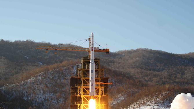 FILE - In this Dec. 12, 2012 file photo released by Korean Central News Agency, North Korea's Unha-3 rocket lifts off from the Sohae launch pad in Tongchang-ri, North Korea. After three nuclear tests of apparently increasing power and a long-range rocket launch that puts it a big step closer to having a missile that can carry a nuclear warhead to American shores, many believe that, in a matter of years - as little as five, maybe, though the timeframe is a point of debate - Pyongyang will have a very scary nuclear arsenal. Though it's a view not embraced by everyone, one respected South Korean expert says North Korea could be working toward 80 to 100 nuclear-tipped missiles. (AP Photo/KCNA, File)