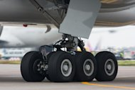 Wheel-well stowaways board planes by climbing the landing gear of a plane preparing for takeoff. Seen here is the landing gear of a Boeing 777.