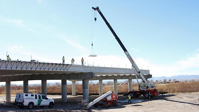 A Border Patrol truck is seen the at the Tornillo-Guadalupe border bridge construction in Tornillo, Texas, Friday, Jan. 18, 2013. The bi-national project is nearly finished in the U.S. side, while work has not started on the Mexican side of the river.(AP Photo/Juan Carlos Llorca)