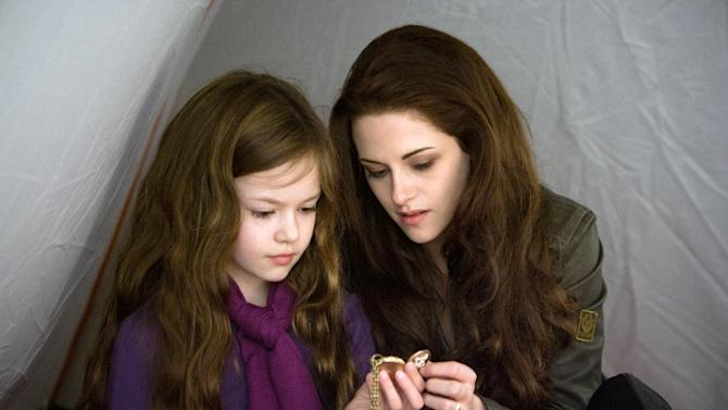"""This film image released by Summit Entertainment shows Mackenzie Foy, left, and Kristen Stewart in a scene from """"The Twilight Saga: Breaking Dawn Part 2."""" (AP Photo/Summit Entertainment, Andrew Cooper)  Ph: Andrew Cooper, SMPSP © 2011 Summit Entertainment, LLC.  All rights reserved."""