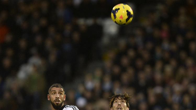 Fulham's Dejagah and Manchester City's Silva eye the ball during their English Premier League soccer match at Craven Cottage in London