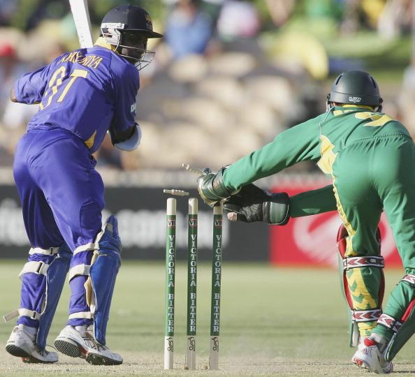 ADELAIDE, AUSTRALIA - JANUARY 24:  Sanath Jaysuriya of Sri Lanka is stumped by Mark Boucher of South Africa during Game 6 of the VB Series between South Africa and Sri Lanka played at the Adelaide Ova