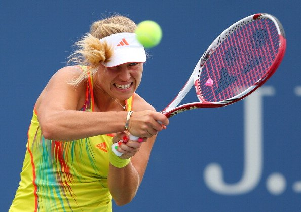 Angelique Kerber of Germany returns a shot against Sara Errani of Italy during their women's singles fourth round match Day Eight of the 2012 US Open at USTA Billie Jean King National Tennis Center on