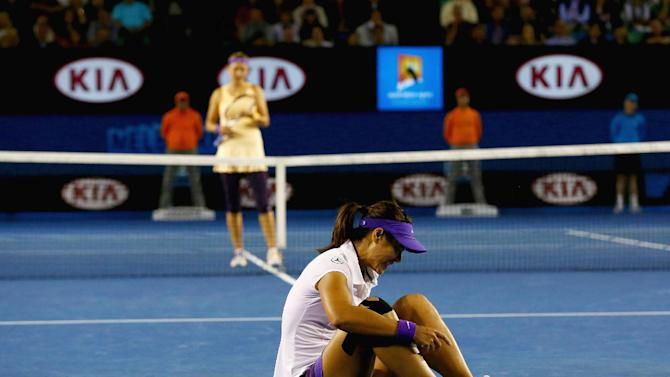 China's Li Na tries to get up after falling during her match against Victoria Azarenka of Belarus in the women's final at the Australian Open tennis championship in Melbourne, Australia, Saturday, Jan. 26, 2013. (AP Photo/Ryan Pierse,Pool)