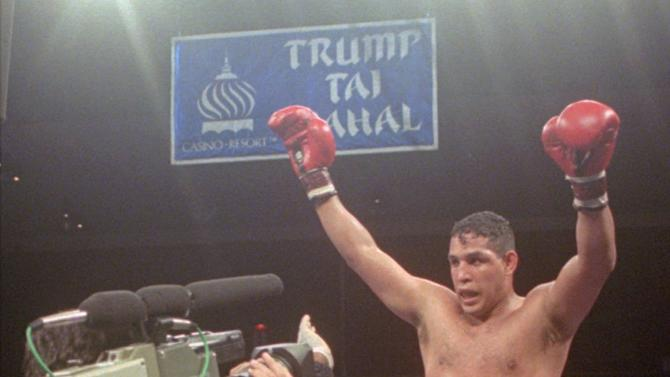 "FILE - This June 22, 1996, file photo shows Hector ""Macho"" Camacho being lifted into the air after his unanimous decision over Roberto Duran in an IBC middleweight title fight at the Trump Taj Mahal Casino Resort in Atlantic City, N.J. Police in the Puerto Rican city of Bayamon say they found drugs inside the car in which former champion boxer Camacho was shot and critically wounded. Camacho was in critical condition Wednesday, Nov. 21, 2012, at the Centro Medico trauma center in San Juan. (AP Photo/Donna Connor, File)"