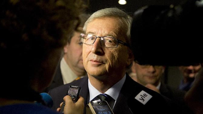 Leader of the Christian Democrat party Jean-Claude Juncker speaks with the media at his election headquarters in Luxembourg on Sunday, Oct. 20, 2013. The Christian Democrat party of long-serving Prime Minister Jean-Claude Juncker easily remained the biggest party and the first choice to form a new coalition government following the first provisional results of Sunday's elections. (AP Photo/Virginia Mayo)