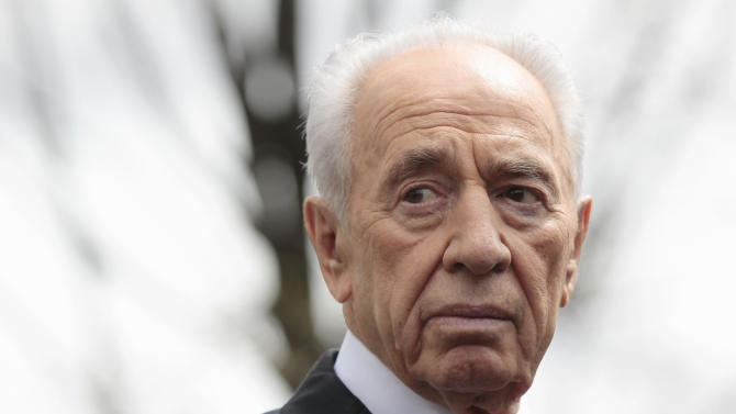 FILE - In this April 5, 2011 file photo Israeli President Shimon Peres speaks to members of the media outside White House in Washington following his meeting with President Barack Obama. The dim prospects for Israel's dovish opposition in upcoming elections is raising speculation that 89-year-old President Shimon Peres may make one last run to be prime minister. Peres is under pressure from political allies to seek the premiership, according to officials in his office. For now, they said on Nov. 4, 2012, he has no plans of stepping down from his current post. (AP Photo/Pablo Martinez Monsivais, File)