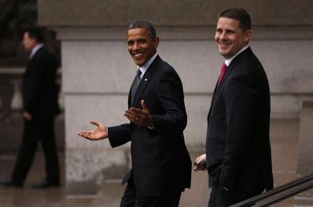 U.S. President Barack Obama gestures as he walks back to the White House from the Treasury in Washington