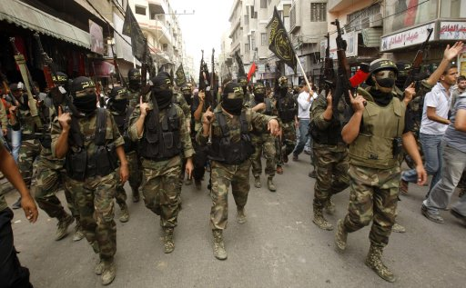 Islamic Jihad militants take part in the funeral of their comrades in the Gaza Strip