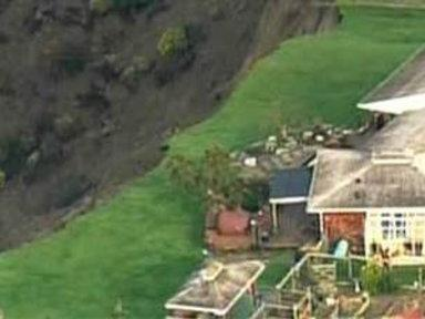 Thunderous Landslide Leaves Homes in Danger