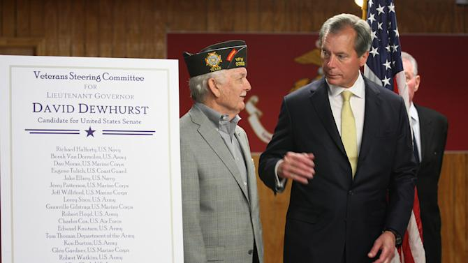 Texas Lt. Gov. David Dewhurst talks with former Veterans of Foreign Wars Commander-in-Chief Glen Gardner, during a campaign stop at the VFW Post 76, in San Antonio, Monday, July 30, 2012. Dewhurst was courting the veteran's vote on the last day before the U.S. Senate runoff election with Tea Party candidate Ted Cruz. Gov. Rick Perry accompanied Dewhurst during the stop. (AP Photo/San Antonio Express-News, Jerry Lara) MAGS OUT NO SALES  SAN ANTONIO OUT