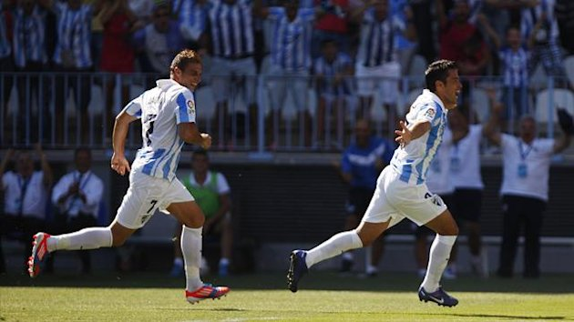 Malaga&#39;s Javier Saviola (R) celebrates next to his teammate Joaquin Sanchez after scoring a goal against Levante during their Spanish first division (Reuters)