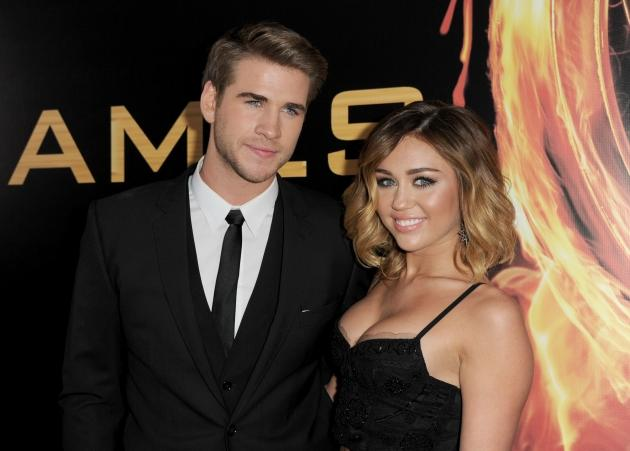 Liam Hemsworth and Miley Cyrus arrive at the premiere of Lionsgate's 'The Hunger Games' at Nokia Theatre L.A. Live in Los Angeles on March 12, 2012  -- Getty Images