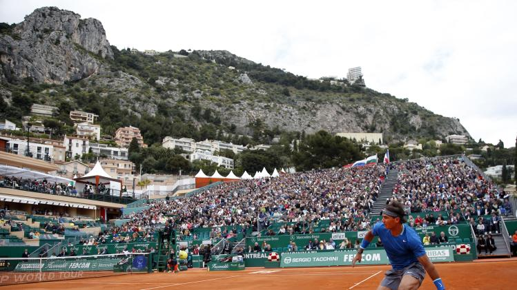 Rafael Nadal of Spain returns the ball to Teymuraz Gabashvili of Russia during the Monte Carlo Masters in Monaco