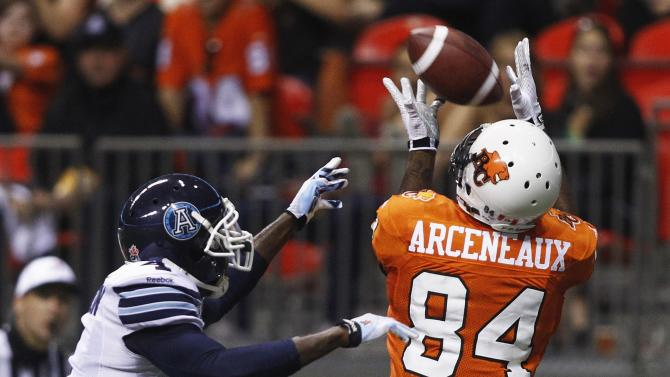 BC Lions' Emmanuel Arceneaux catches a pass for a touchdown against Toronto Argonauts' Jamie Robinson during the first half of their CFL football game in Vancouver