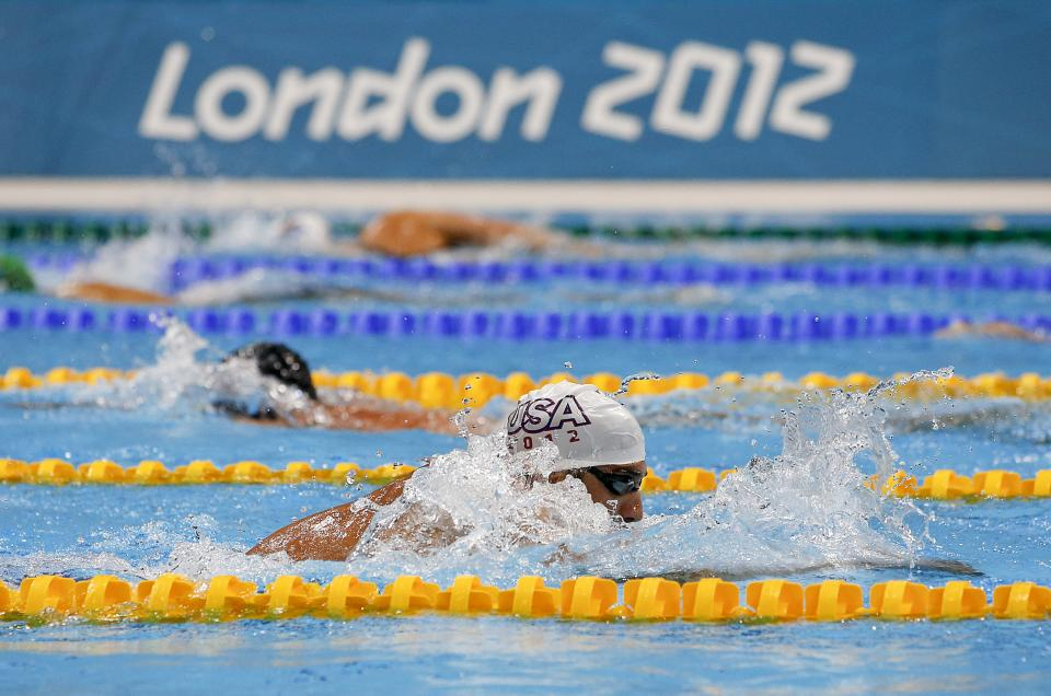 Michael Phelps trains at the Aquatics Center at the Olympic Park, Monday, July 23, 2012, in London. Opening ceremonies for the 2012 London Olympics will be held Friday, July 27. (AP Photo/Jae C. Hong)