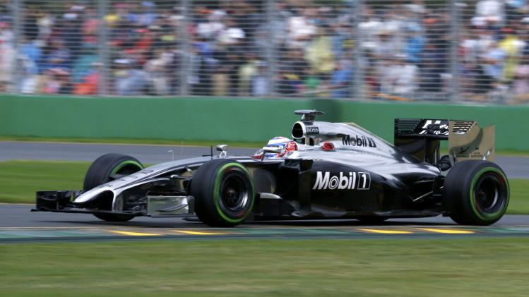 McLaren Formula One driver Button of Britain drives during the qualifying session for the Australian F1 Grand Prix at the Albert Park circuit in Melbourne