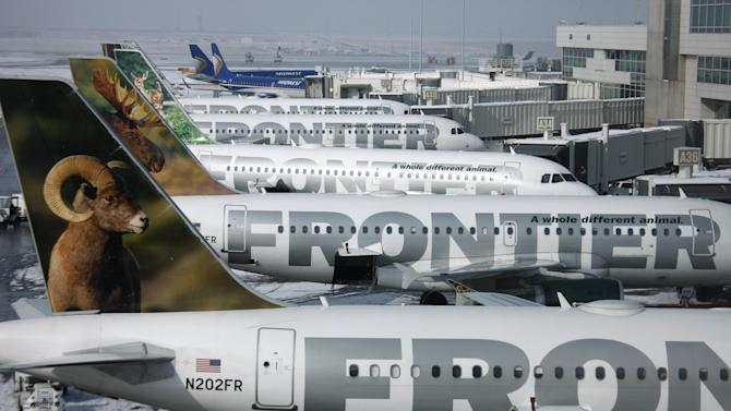 FILE - In this Feb. 22, 2010 file photo, Frontier Airlines jetliners sit stacked up at gates along the A concourse at Denver International Airport. Passengers flying Frontier Airlines will now have to pay extra to place carry-on bags in overhead bins or for advance seat assignments. The move comes as the Denver-based airline transforms itself into a fee-dependent airline, similar to Spirit Airlines or Allegiant Air _ the only other U.S. carriers to charge such fees. (AP Photo/David Zalubowski, File)