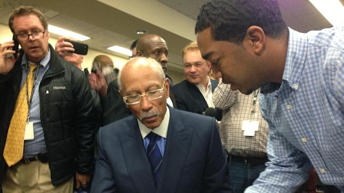 Detroit Mayor Dave Bing prepares to sign for nominating petitions needed if he is to make a re-election run. He picked up the petitions Thursday from the Detroit City Clerk's office. May 14 is the filing deadline for the city's August primary. Voters elected Bing in 2009 to his first term as mayor.  (AP Photo/Corey Williams)