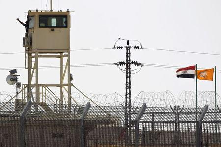 A member of Egypt's security forces stands on watchtower in North Sinai