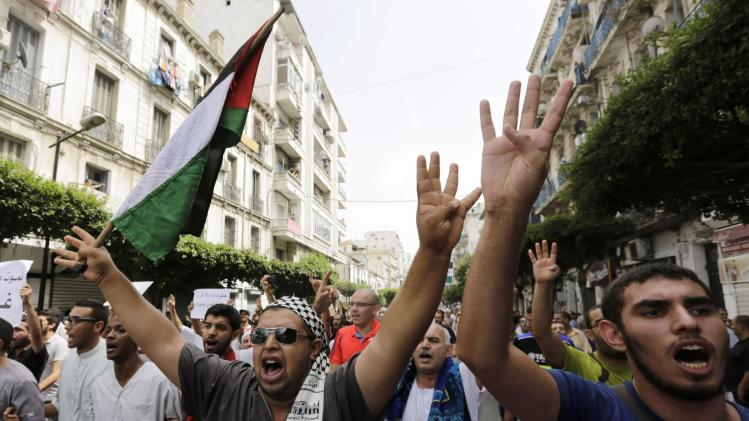 Pro-Palestinian protesters shout slogans during a demonstration against Israel's military action in the Gaza strip, in Algiers
