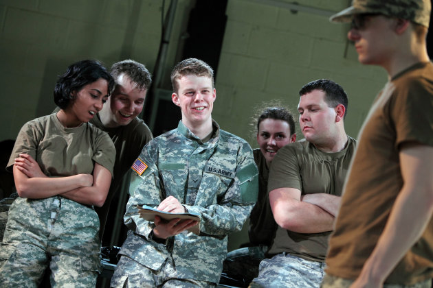 "In this photo provided by the National Theatre Wales, on Friday April 20, 2012 Matthew Aubrey,center, plays U.S. Army Pfc. Bradley Manning in the play ""The Radicalization of Bradley Manning."" To some he's a traitor to his country, to others a free-speech hero. But before he was a public enemy or a cause celebre, U.S. soldier and alleged WikiLeaks source Bradley Manning was a high-school student in west Wales a pivotal period that is the subject of a new British play.(AP Photo/ Farrows Creative / National Theatre Wales)"