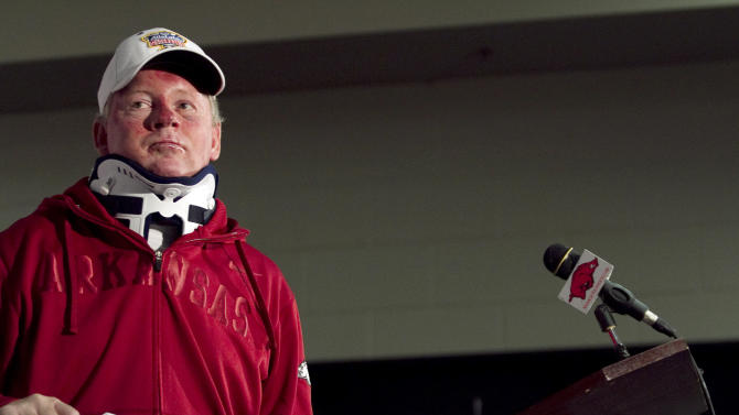 In this Tuesday, April 3, 2012, photo, Arkansas football coach Bobby Petrino speaks during a news conference in Fayetteville, Ark. Petrino has been put on paid leave. Athletic director Jeff Long announced the decision late Thursday, April 5, capping a stunning day in which it was revealed that Petrino had a 25-year-old female employee with him during a weekend motorcycle ride that ended in a crash. (AP Photo/Gareth Patterson)