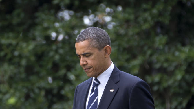 President Barack Obama walks from the Oval Office of the White House in Washington, Tuesday, Aug. 28, 2012, to Marine One, en route to Iowa. (AP Photo/Carolyn Kaster)