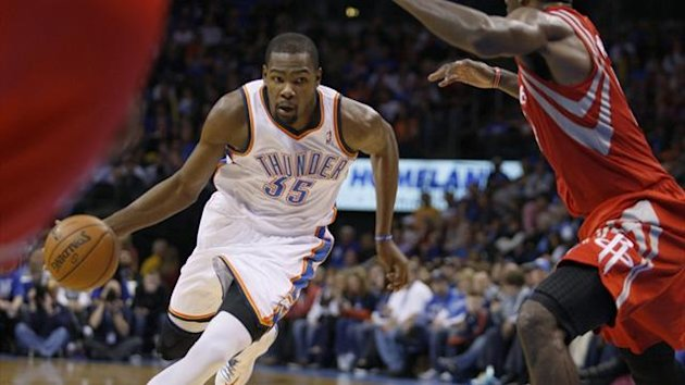 Oklahoma City Thunder forward Kevin Durant drives against Houston Rockets forward Patrick Patterson (Reuters)