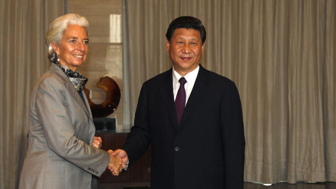 International Monetary Fund (IMF) managing director Christine Lagarde, left, and China's President Xi Jinping pose for photos before their meeting at the annual Boao Forum in Boao, in southern China's Hainan province, Monday, April 8, 2013. (AP Photo/Tyrone Siu, Pool)