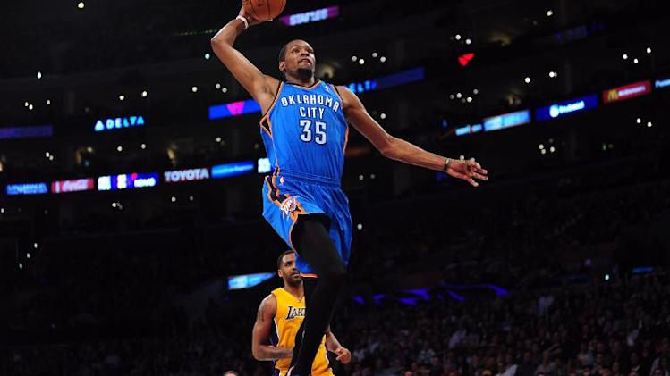 Kevin Durant of the Oklahoma City Thunder scores off a slam dunk during their NBA game against the Los Angeles Lakers at Staples Center on February 13, 2014