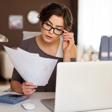 Young-woman-working-hard-at-home_web
