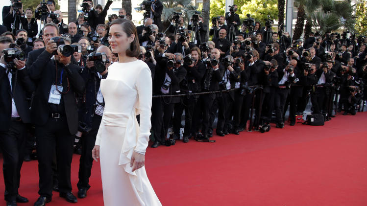 Actress Marion Cotillard arrives for the screening of The Immigrant at the 66th international film festival, in Cannes, southern France, Friday, May 24, 2013. (AP Photo/Francois Mori)