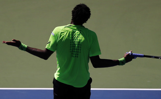 Gael Monfils, of France, reacts after a shot to Alejandro Gonzalez, of Colombia, during the second round of the U.S. Open. (AP Photo/Elise Amendola)