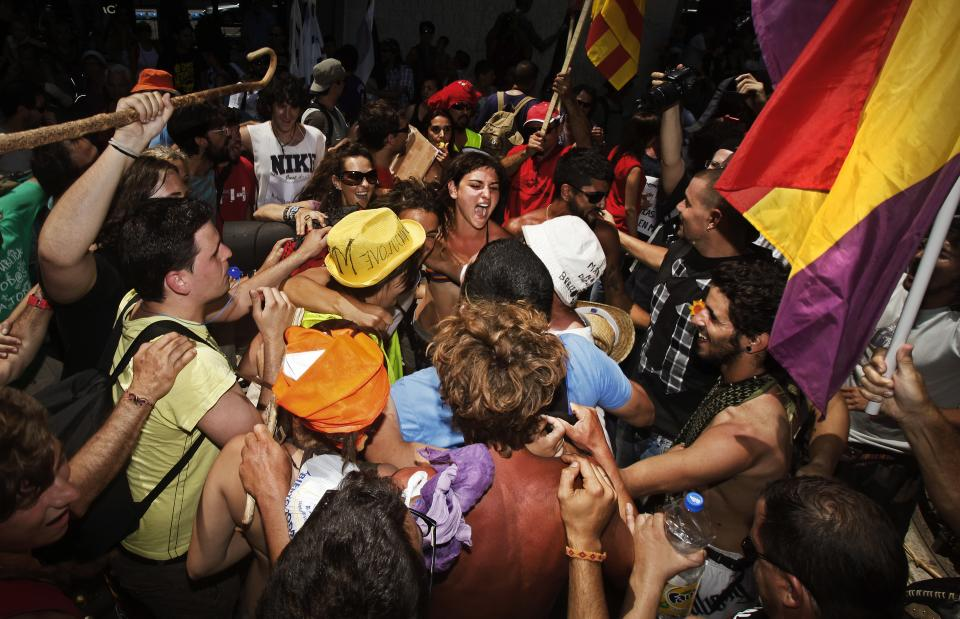 Protesters meet after traveling to Madrid from many parts of Spain to demonstrate against the country's near 25 percent unemployment rate and stinging austerity measures introduced by the government in Madrid, Spain, Saturday, July 21, 2012. (AP Photo/Andres Kudacki)