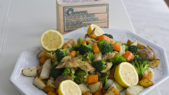 This undated image shows soaked salt cod that becomes a meaty and delicious dinner with roasted potatoes and vegetables. (AP Photo/Matthew Mead)