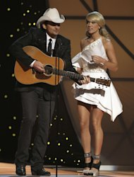 FILE - In this Nov. 9, 2011 file photo, hosts Brad Paisley, left, and Carrie Underwood speak during the 45th Annual CMA Awards in Nashville, Tenn. The former American Idol winner&#39;s latest album Blown Away was a multi-week No. 1 on the country albums chart, she&#39;s in the midst of an arena tour and she also is up for female vocalist of the year at the CMA Awards, on Thursday, Nov. 1, 2012, airing live on ABC at 8 p.m. EDT from Nashville&#39;s Bridgestone Arena. (AP Photo/Mark Humphrey, File)