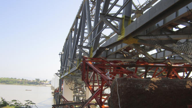 Structures of a bridge under construction across the Irrawaddy River, east of Shwebo, Myanmar are seen damaged after a strong earthquake on Sunday, Nov. 11, 2012. The magnitude-6.8 quake struck northern Myanmar on Sunday, collapsing the bridge and a gold mine, damaging several old Buddhist pagodas and leaving as many as 12 people feared dead. The bridge links the town of Sintku, 65 kilometers (40 miles) north of Mandalay on the east bank of the Irrwaddy with Kyaukmyaung on the west bank. (AP Photo/Weekly Eleven News) MANDATORY CREDIT