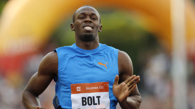 Jamaica's Usain Bolt competes in a Men's 100m race at the Golden Spike Athletic meeting in Ostrava, Czech Republic, Friday, May 25, 2012. (AP Photo/Petr David Josek)