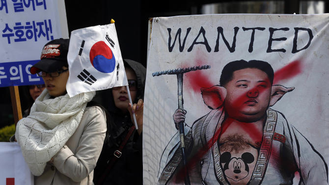 South Korean protesters hold an anti-North Korea rally with a defaced image of North Korean leader Kim Jong Un, at downtown Seoul, South Korea Thursday, April 18, 2013. North Korea would collapse without support from its economic benefactor China, U.S. Secretary of State John Kerry, who was on Asian tour last week, said Wednesday, stressing the importance of working with Beijing to address North Korean threats and its nuclear program. (AP Photo/Kin Cheung)
