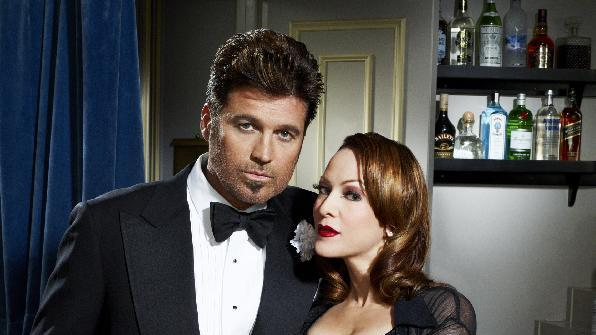 """This undated theater image released by The Publicity Office shows, Billy Ray Cyrus, left, and Cristy Candler starring in the musical """"Chicago,"""" beginning Nov. 5, and running through Dec. 23, at the Ambassador Theatre in New York. (AP Photo/The Publicity Office, Andrew Eccles)"""