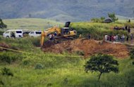 Military personnel search a shallow grave on November 24, 2009 in Ampatuan town, Maguindanao province, for the bodies of massacre victims. More than 100 suspects in the Philippines' worst political massacre are in custody after another member of a prominent political clan linked to the 57 killings was arrested, police said Wednesday