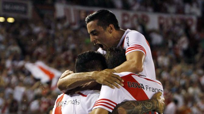 Players of River Plate celebrate Mercado scoring a goal against Libertad during their Copa Sudamericana soccer match Buenos Aires