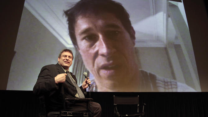 "This Sept. 13, 2012 photo shows Richard Pena, director of the New York Film Festival (NYFF), hosting a live interview via Skype video with film director Bertrand Bonello, following a press screening of his festival entry ""Ingrid Caven: Voice and Music"" in New York.  Pena will step down as head of the Film Society of Lincoln Center and the NYFF  after this year's 50th Anniversary of NYFF presentation, a post he has held for 25 years.  (AP Photo/Bebeto Matthews)"