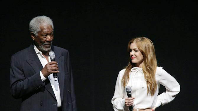 "Morgan Freeman and Isla Fisher, cast members in the upcoming film ""Now You See Me"" at Lionsgate Presentation at 2013 CinemaCon, on Thursday, April, 18th, 2013 in Las Vegas. (Photo by Eric Charbonneau/Invision for Lionsgate/AP Images)"