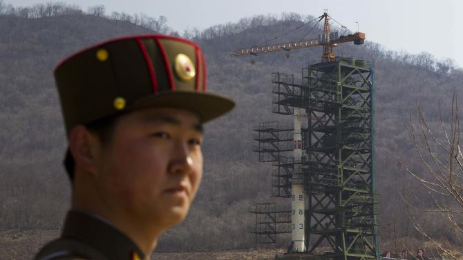 FILE - In this April 8, 2012 file photo, a North Korean soldier stands in front of the country's Unha-3 rocket at a launching site in Tongchang-ri, North Korea. It really is rocket science and it really is hard. North Korea proved that again. The giant explosion that gets a rocket off the ground isn't that complicated. Controlling that reaction and going where you want, when you want - that's where engineers earn their money and ulcers. And it's where past rockets and spaceships have ended in spectacular and sometimes deadly failures. (AP Photo/David Guttenfelder, File)